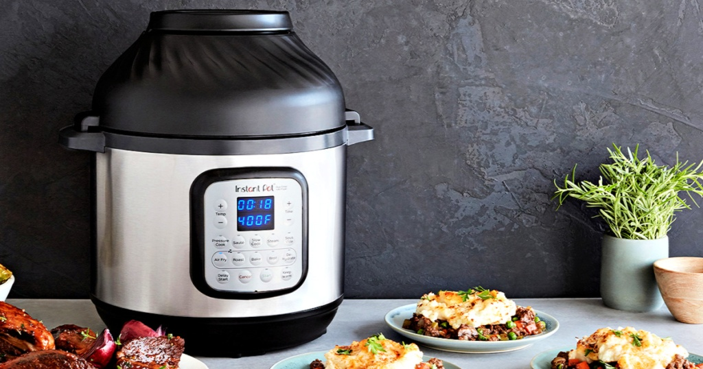Instant Pot Duo Crisp 8-Quart Pressure Cooker AND Air Fryer on counter with food