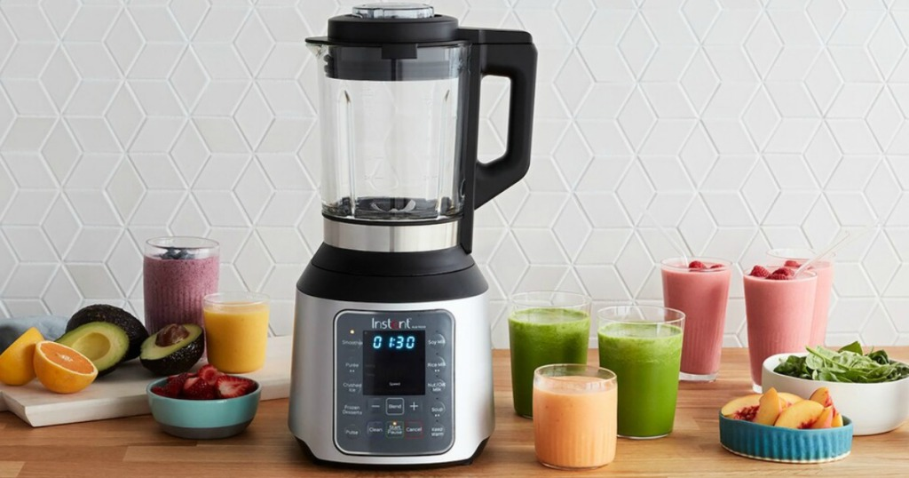 Instant Pot Nova Blender on table with fruit and smoothies