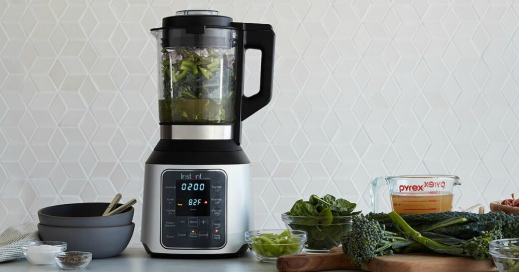 Instant Pot Nova Blender on table with vegetables