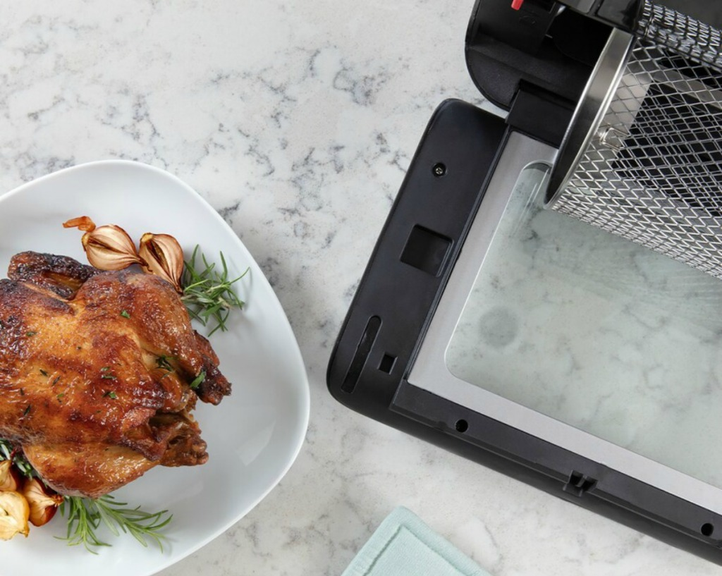 cooked chicken next to air fryer oven