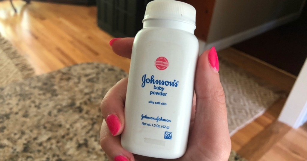 Woman holding bottle of Johnson's Baby Powder