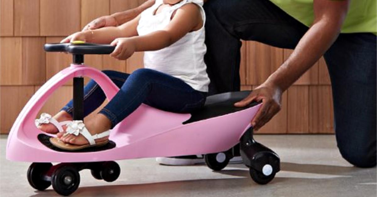 girl riding pink swing car ride on