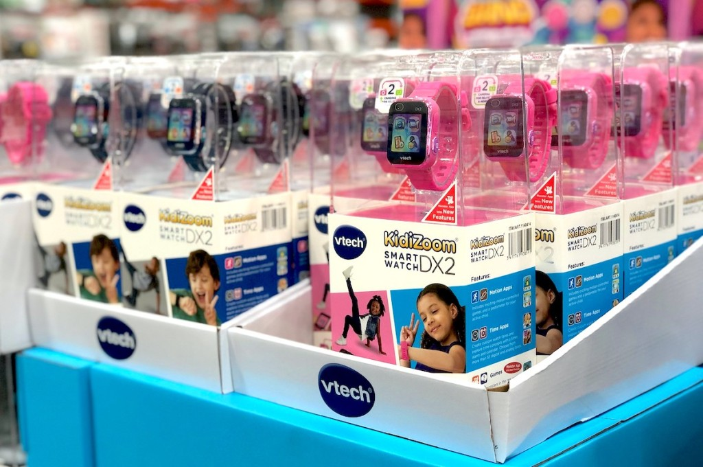 bright pink and black kidizoom watches in packages on store display shelf