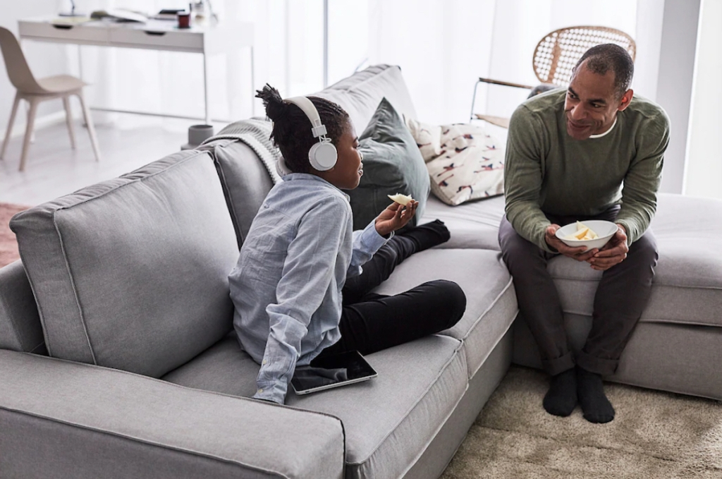 family sitting on gray sectional couch sofa from IKEA