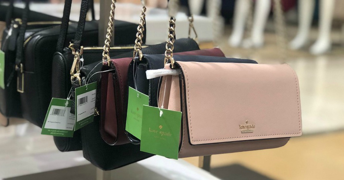 Kate Spad purses hanging at a store