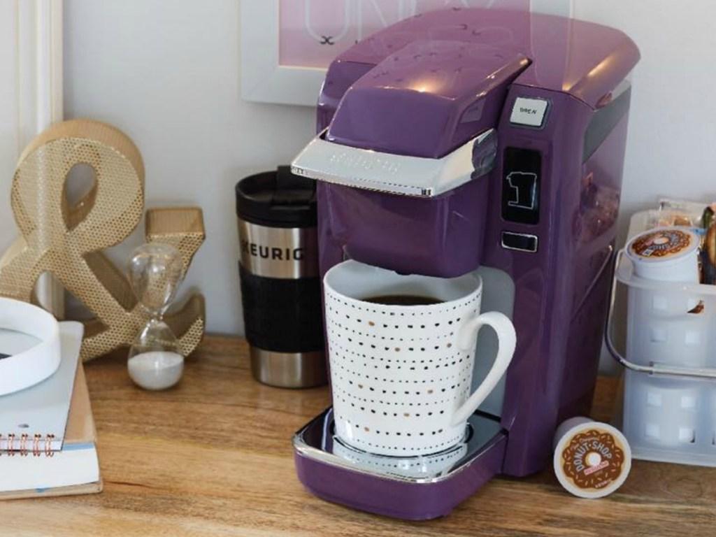 Keurig Mini Coffee Brewer in Plum purple on counter in dorm