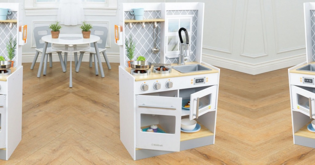 KidKraft Let's Cook Wooden Play Kitchen in playroom