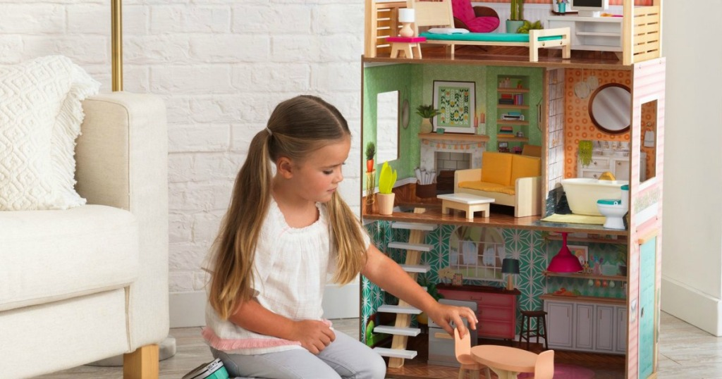 girl playing with kidkraft vintage dottie dollhouse