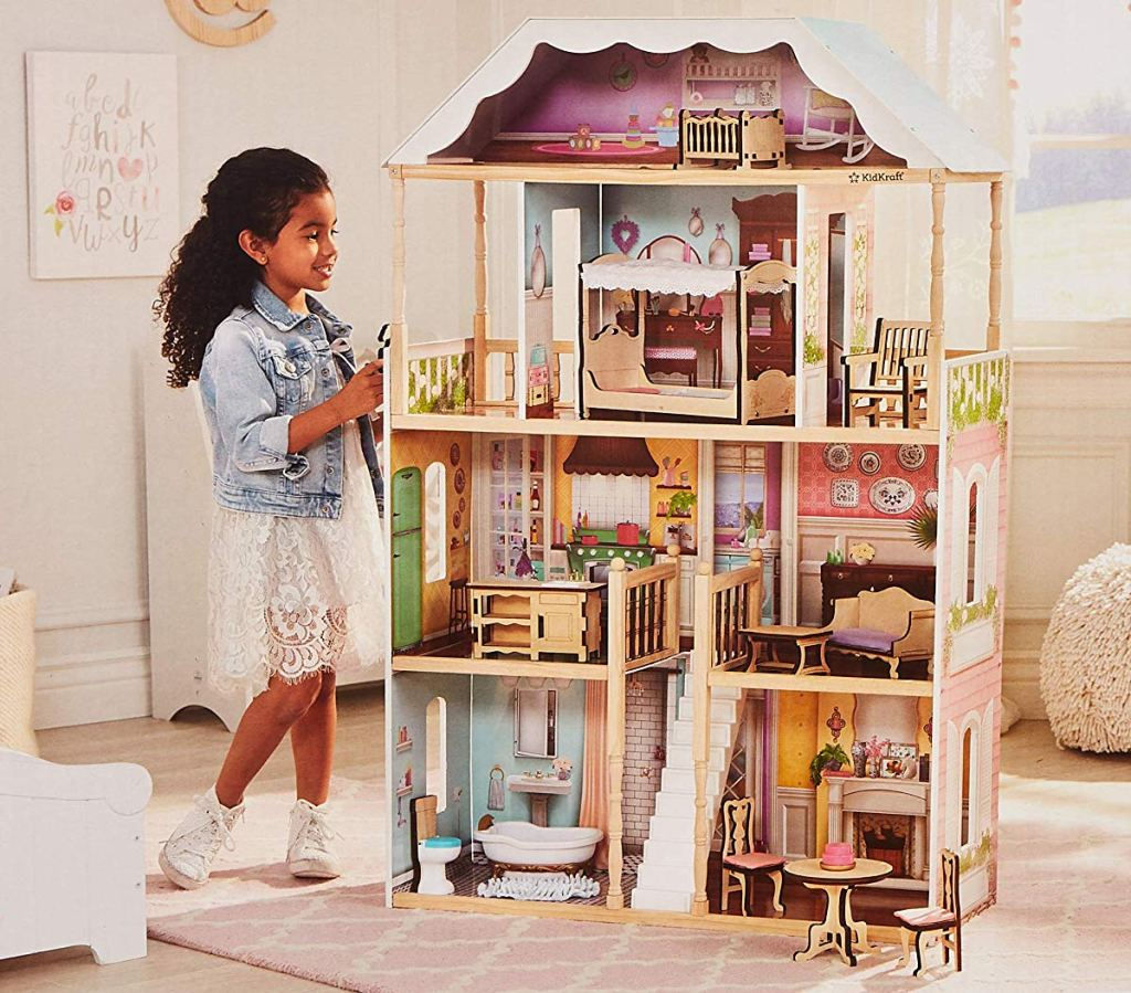 girl playing with Kidkraft Charlotte dollhouse