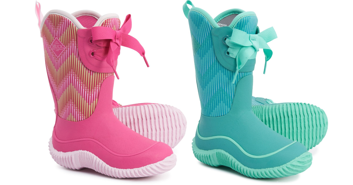 two pairs of kids muck boots in pink and blue