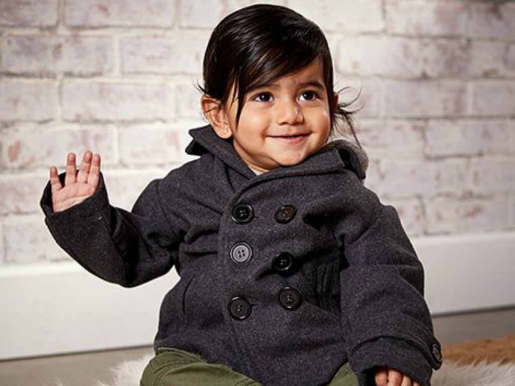 Toddler wearing a black peacoat from Zulily