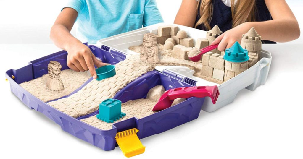 kids playing with kinetic sand in folding sandbox