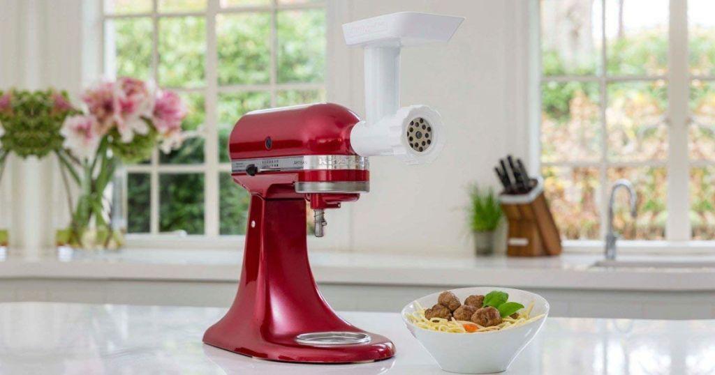 Red KitchenAid mixer with Grinder