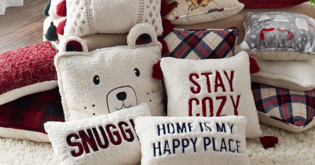 pile of Cuddl Duds Throw Pillow Collection on rug