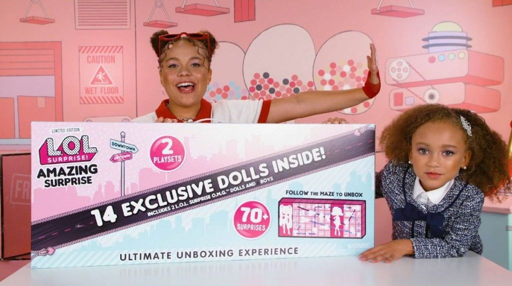 girls with L.O.L. Surprise! Amazing Surprise with 14 Dolls & 70+ Surprises box
