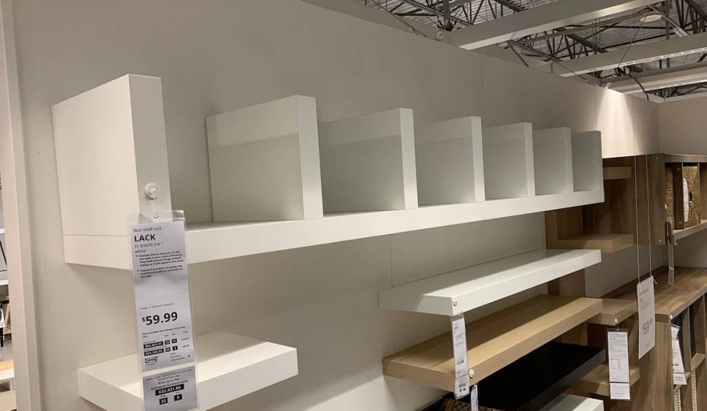white shelf with cubbies hanging on wall