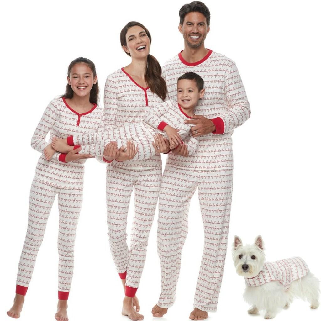 Family and dog wearing LC Lauren Conrad Jammies Fa La La