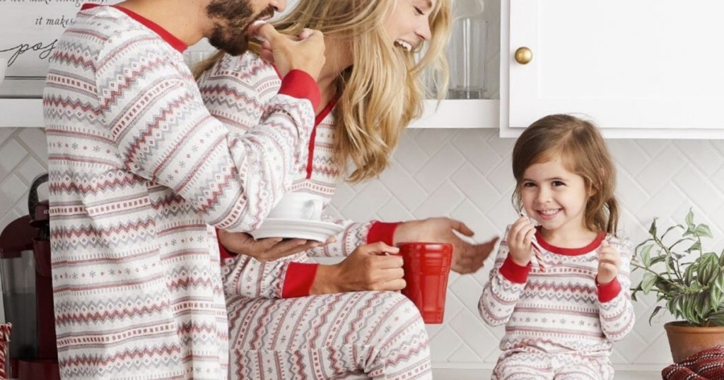 Family wearing matching jammies from Kohl's in their kitchen