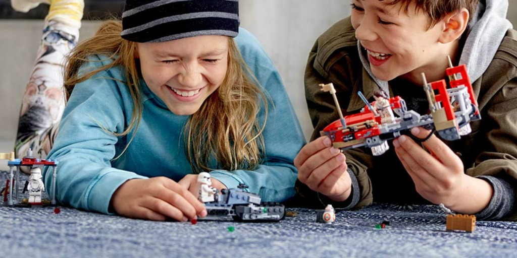 Boy and girl playing with a LEGO Star Wars Pasaana Speeder Chase set