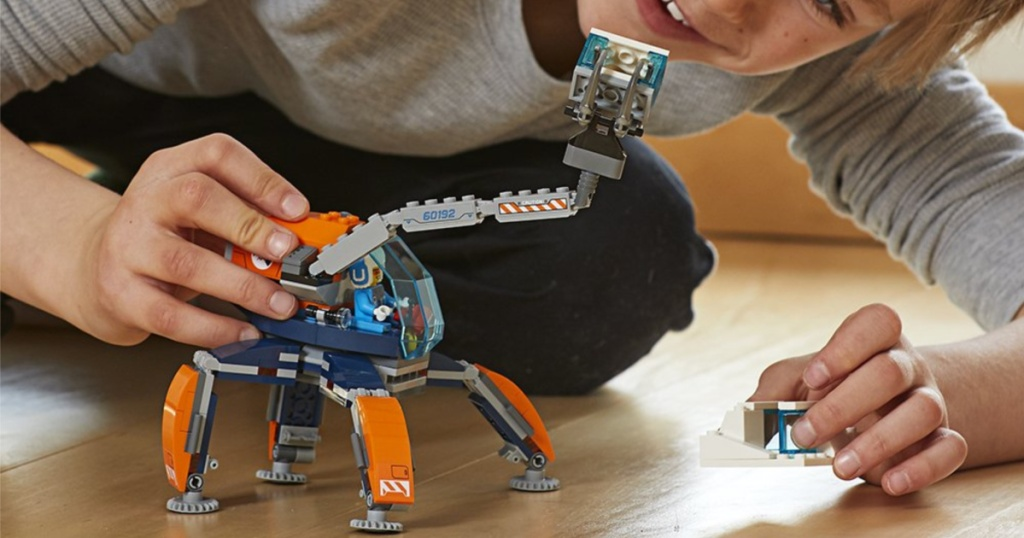 boy playing with lego arctic ice crawler building kit