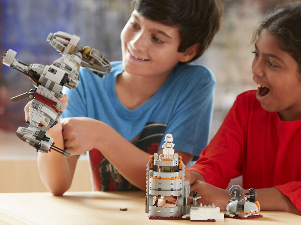 boys playing with LEGO Star Wars Defense of Crait