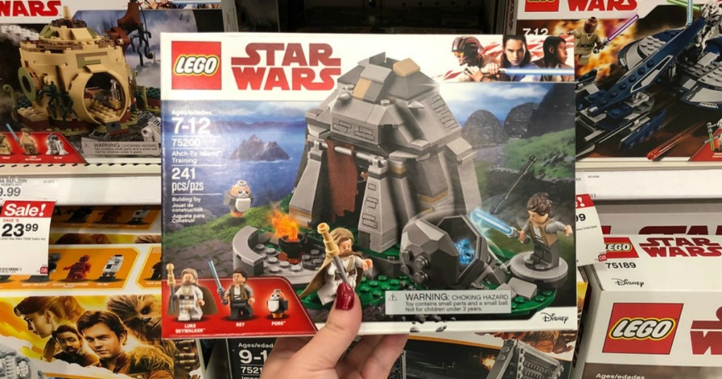 person holding a Lego Star Wars Set