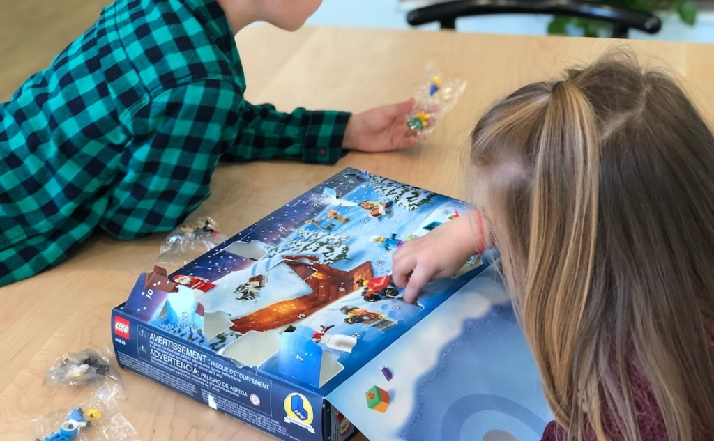 two kids playing with lego advent calendar