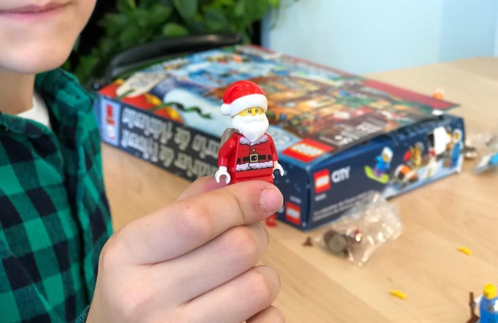 hand holding a lego city santa