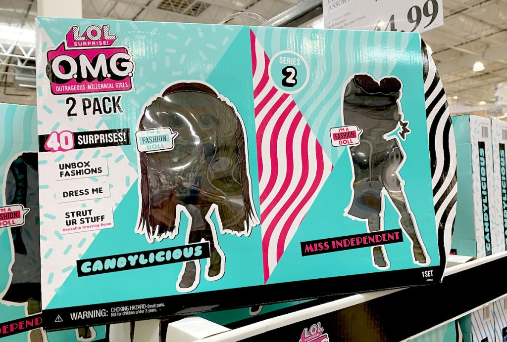 blue and pink boxes of lol dolls stacked on store shelf