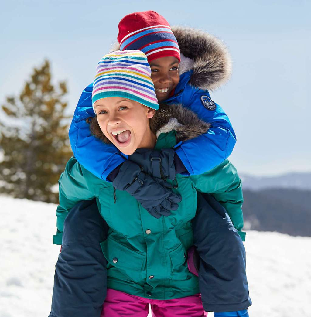 kids wearing colorful lands end jackets in the snow