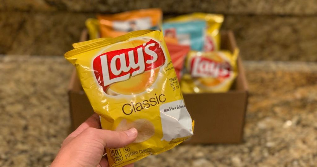 Lay's potato chips in hand