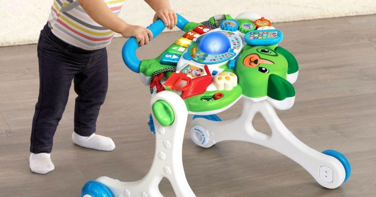child pushing LeapFrog walker