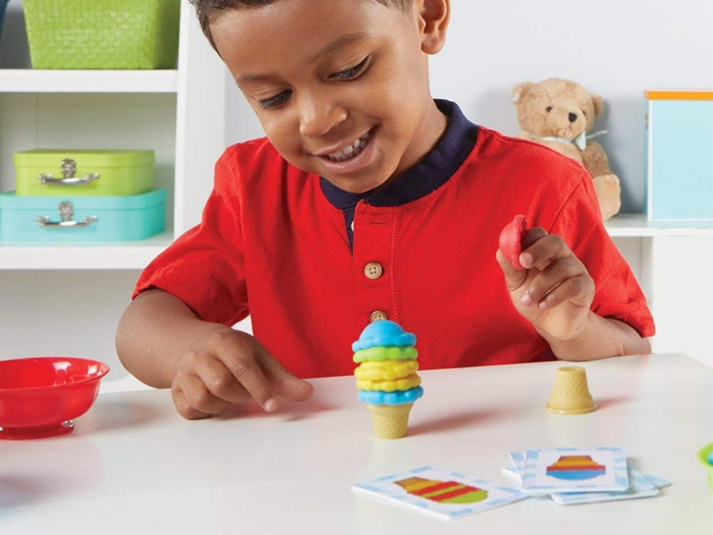 boy playing with scoops activity set
