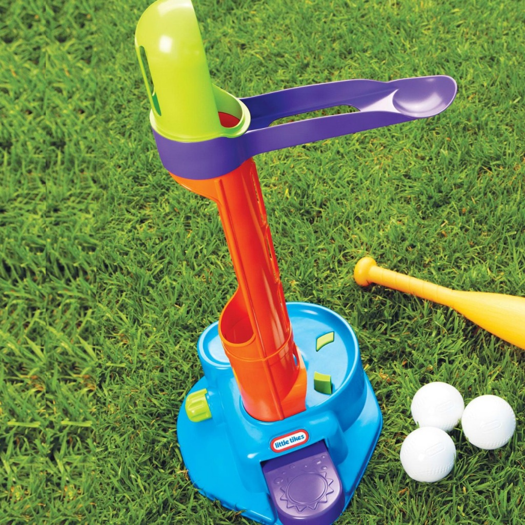 T-Ball playset in yard with bat and three balls