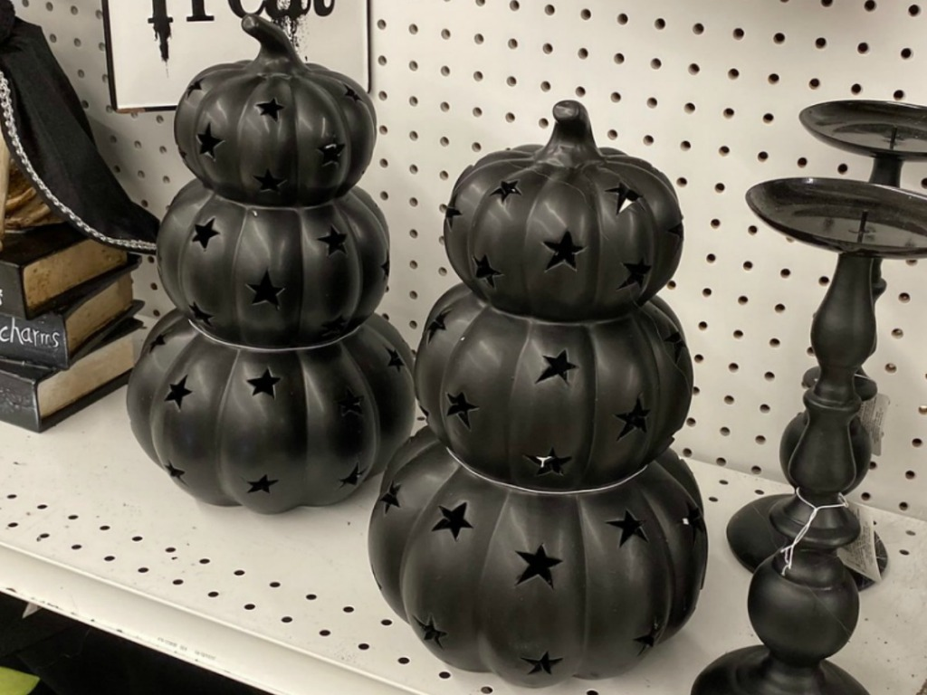 Black Halloween Decoration triple pumpkins stacked on shelf in store