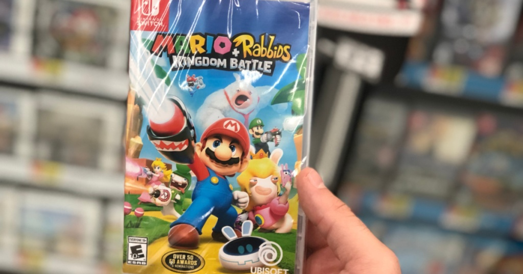 hand holding up mario rabbids game for nintendo switch
