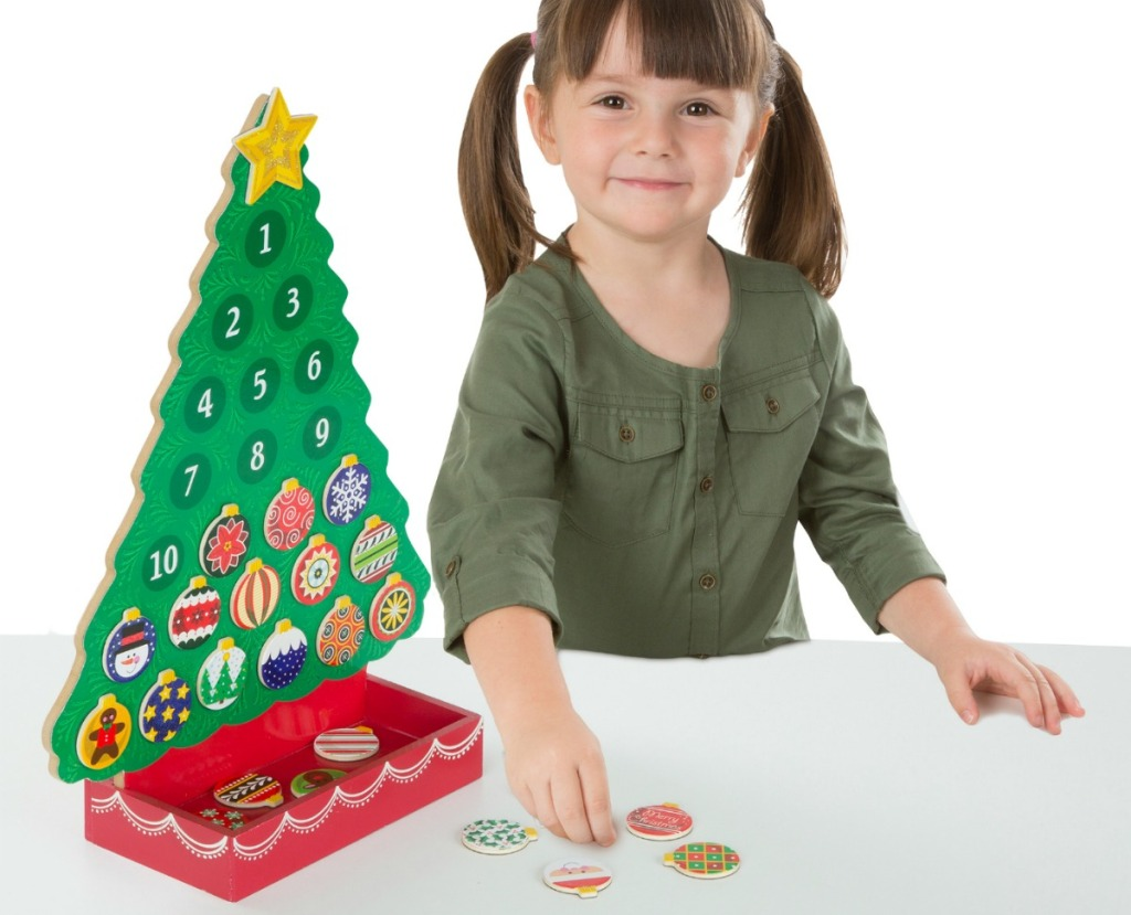 girl playing with Melissa and Doug advent calendar