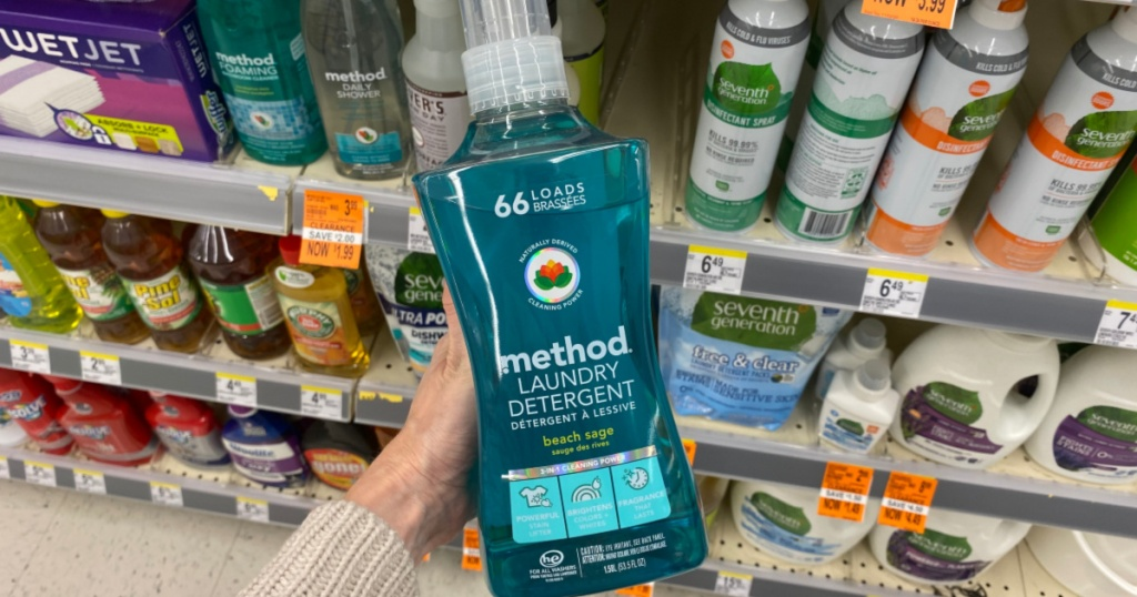 hand holding up bottle of method laundry detergent at walgreens