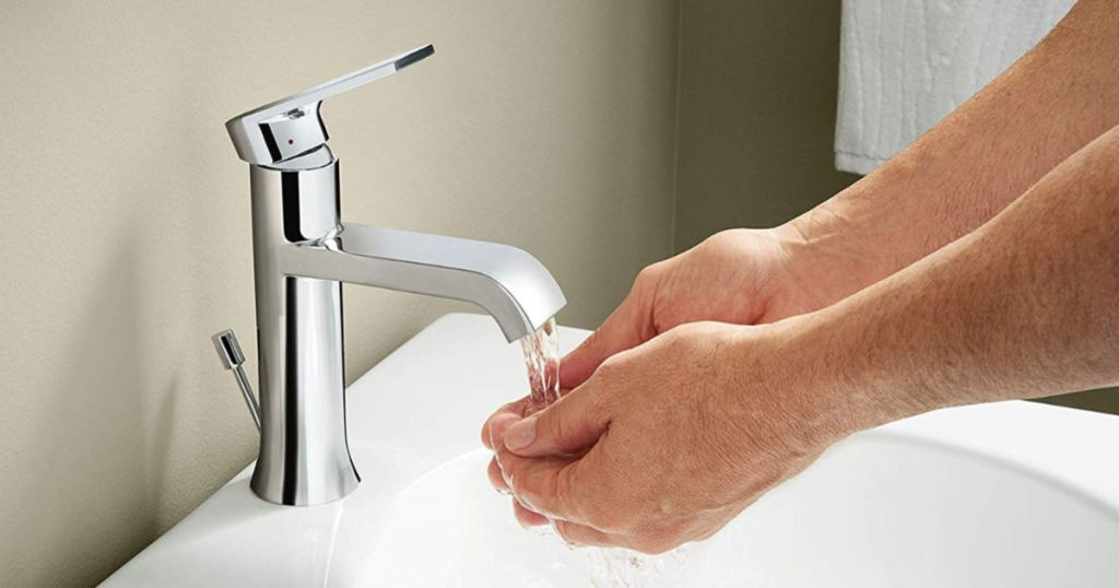 Moen One-Handle Single Hole Bathroom Sink Faucet with person washing hands
