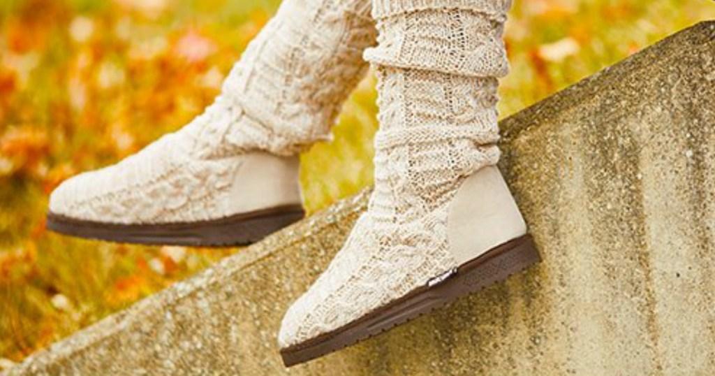 Woman wearing beige/ivory knitted boots in Fall scene