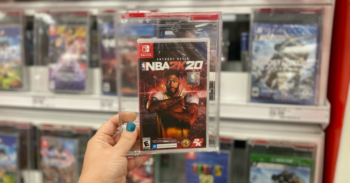 hand holding NBA 2K20 Switch video game up with blurred background