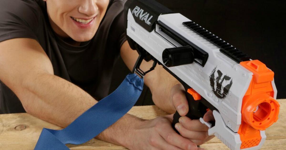 man aiming nerf blaster