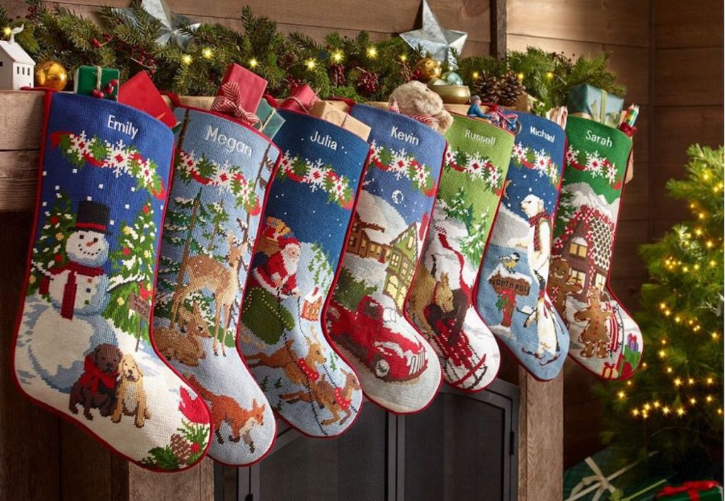 row of traditional christmas stockings hanging on a mantel