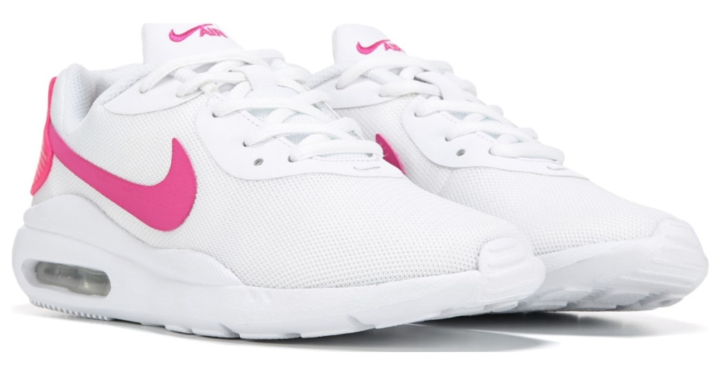 pair of pink and white nike womens sneakers