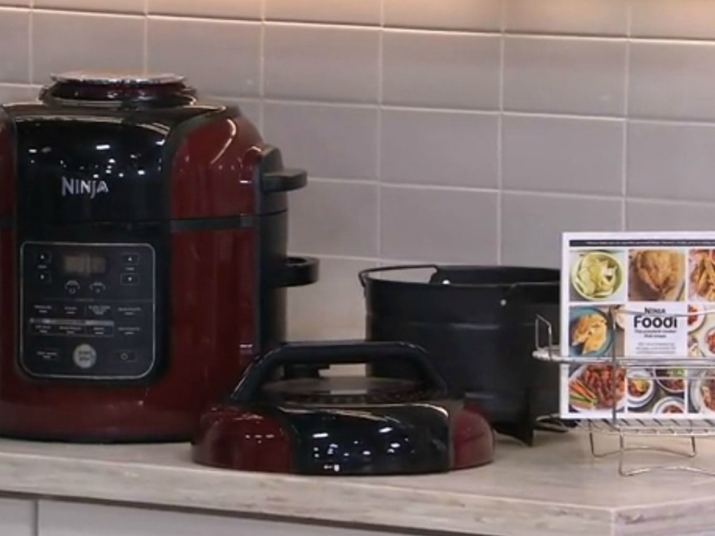 red kitchen appliance with cookbook