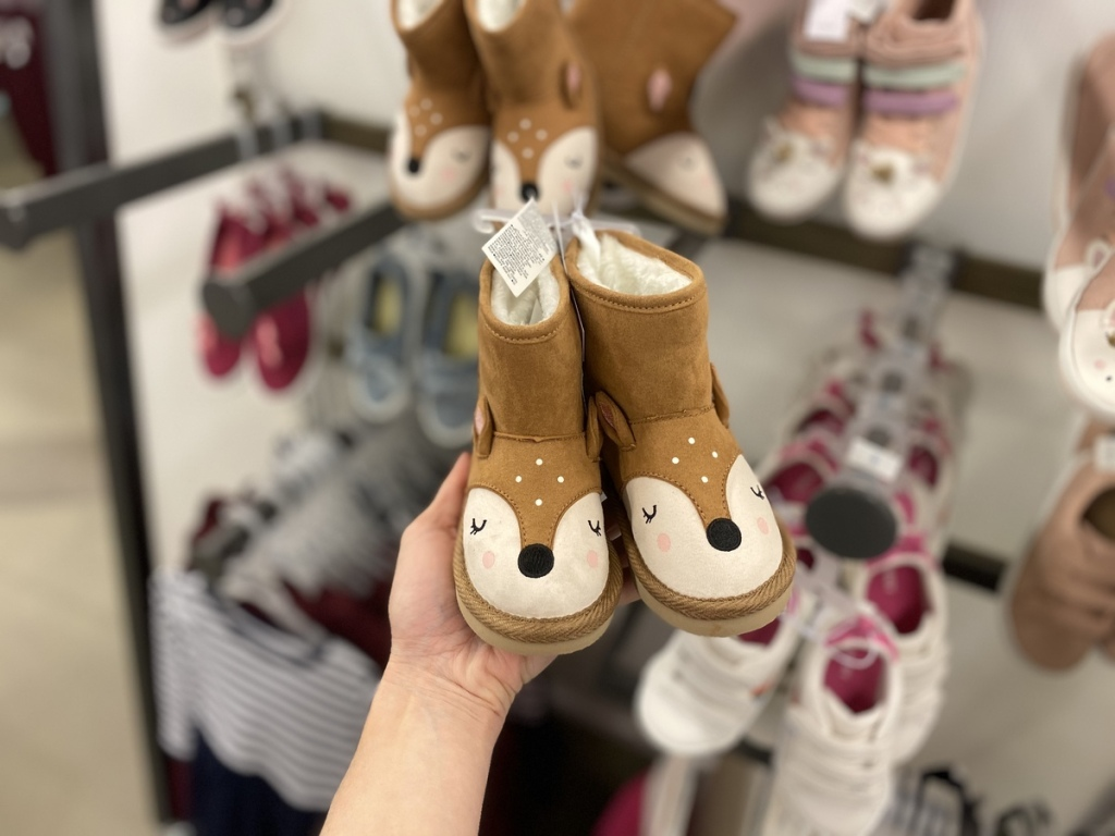 hand holding Old Navy Deer Boots