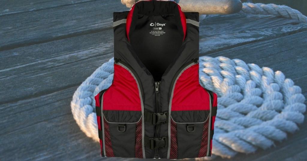 Onyx Deluxe Fishing Life Jacket near nautical scene