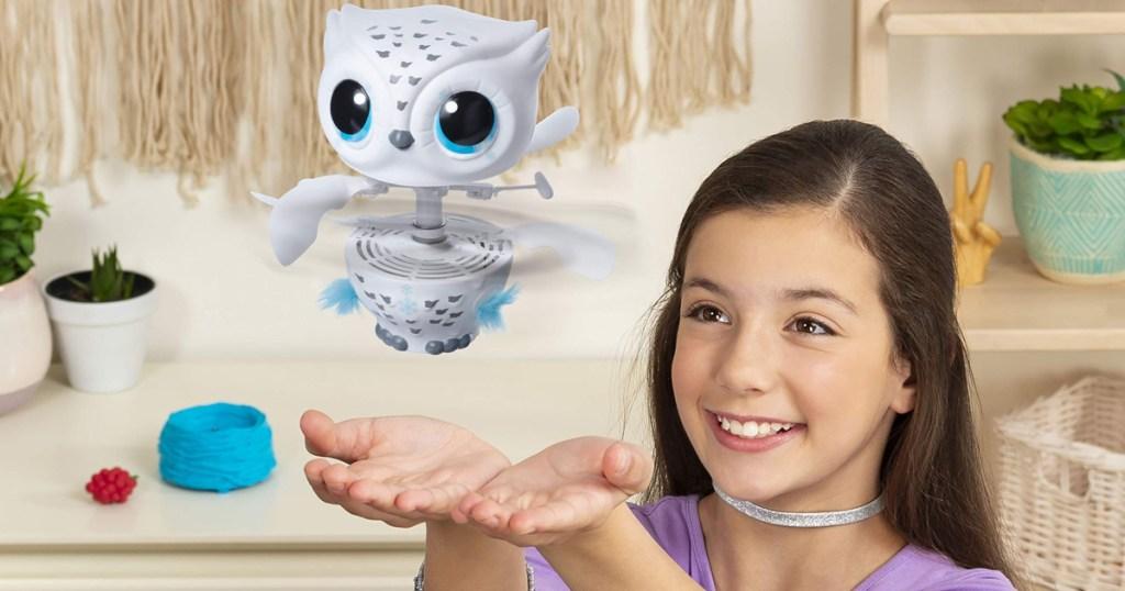 girl playing with owleez flying baby owl toy