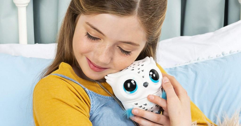 girl cuddling owleez flying baby owl toy