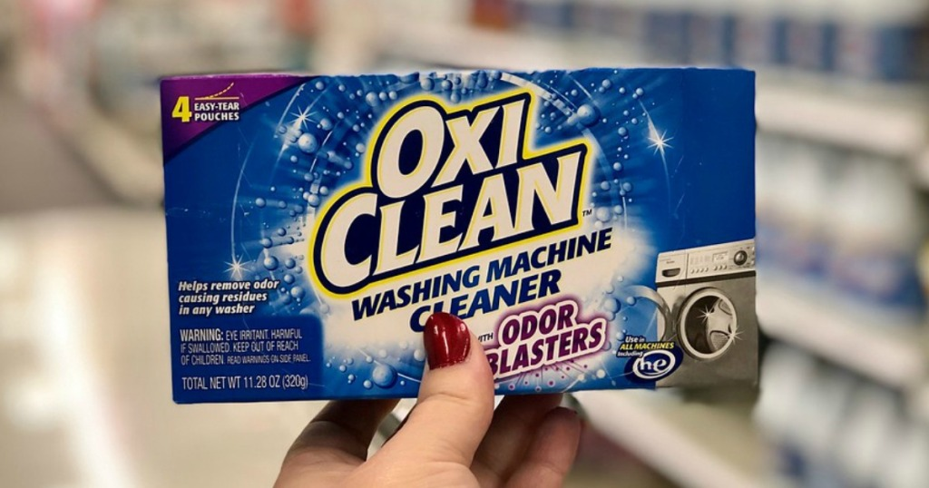 someone holding Oxiclean odor blasters